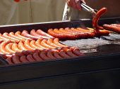 image of grilled sausage  - Grilled sausages on barbecue grill with charcoal - JPG