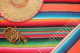 foto of mexican fiesta  - fiesta mexican poncho rug in bright colors with sombrero background with copy space - JPG