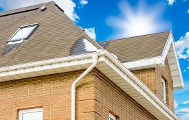 image of red roof  - chimney on the roof of the house against the blue sky - JPG
