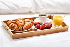 picture of breakfast  - breakfast in bed with coffee croissants strawberries and juice - JPG