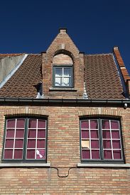 foto of gable-roof  - Gable roof of the brick historic house  - JPG