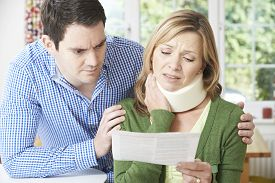 stock photo of neck brace  - Couple Reading Letter In Respect Of Wife