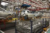 stock photo of manufacturing  - Automotive industry manufacture line with different metal parts - JPG