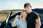 Happy Couple Near New Car