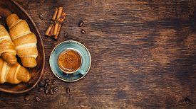 picture of continental food  - Croissants and coffee on a rustic dark background - JPG