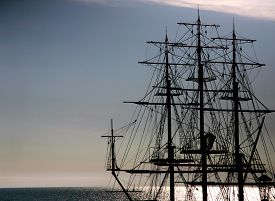 stock photo of historical ship  - the outline of a sailing ship in the sea - JPG