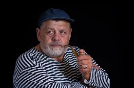 picture of tobacco-pipe  - Portrait of a senior sailor with tobacco - JPG