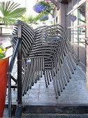Eleven Restaurant Chairs Stacked Upon One Another