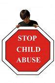 Young man, holding a stop sign, child abuse