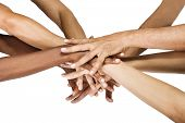 stock photo of mixed race  - Pile of hands isolated on white - JPG