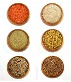 raw red lentils, rice, cereals, bulgor, pasta, country mix soup and buckwheat in the wooden bowls