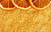 orange aromatic sea salt with some dried slices, background - dried and grinded oranges mixed with s