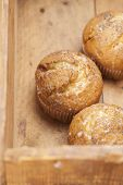 picture of bakeshop  - three poppy seeds and lemon muffins in wooden box - JPG