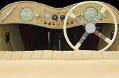 stock photo of mg  - classic car dashboard including steering wheel and dials - JPG