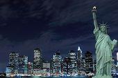The Statue of Liberty and Manhattan skyline at Night, New York City