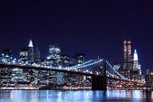 stock photo of new york skyline  - Brooklyn Bridge and Manhattan Skyline At Night - JPG