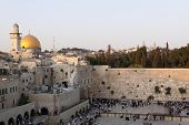 The Temple Mount in Jerusalem, including the Western Wall and the golden Dome of the Rock at Sunset
