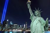 Lower Manhattan Skyline, the Statue of Liberty and the Towers Of Lights at Night