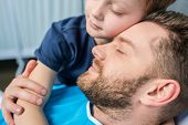 Father With Son Embracing While Laying On Hospital Bed At Ward, Dad And Son poster
