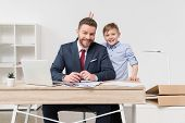 Naughty Boy With His Father Businessman At Office poster