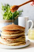 Sweet Homemade Stack Of Pancakes With  Honey For Breakfast  On A Gray Background. Sweet Beautiful Br poster