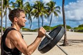 Outdoor calisthenics gym park male athlete working out on T-bar outside in summer. Man workout stren poster