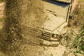 Track On Mud. 4x4 Off-road Suv Car. Offroad Car. Safari. Mud And Water Splash In Off-road Racing. 4x poster