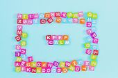 Keep Calm Inscription Made Of Colorful Cube Beads With Letters. Festive Blue Background Concept With poster