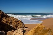 Rocks On The Clean Beach With Dark Yellow Sand. Foamy Waves Of The Atlantic Ocean. Horizon In The Ba poster