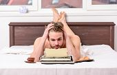 Erotic Literature. Daily Routine Of Writer. Man Writer Lay Bed With Breakfast Working. Writer Handso poster