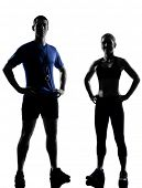 couple woman man exercising workout fitness aerobics posture in silhouette studio isolated on white