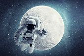 Astronaut In Outer Space Over Full Moon And Stars Background. Elements Of This Image Furnished By Na poster