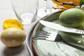 Festive Easter Table Setting With Painted Eggs On Light Background, Closeup poster