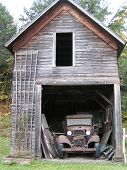 Antique Car In Old Barn