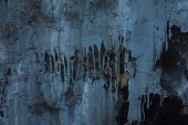 Cracked Blue Paint On A Black Wall, Peeling Blue Paint Stains On The Black Wall. Gray Grunge Backgro poster