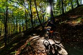 Cycling woman riding on bike in summer mountains forest landscape. Woman cycling MTB flow trail trac poster