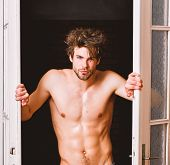 Sexy Attractive Macho Tousled Hair Coming Out Through Bedroom Door. Sexy Bachelor Lover Concept. Guy poster