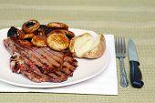 Rib Steak With Mushrooms And Potato
