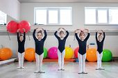 Little Kids Dance In Dance Class. The Concept Of Sport, Education, Childhood, Hobbies And Dance poster