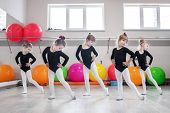 Little Girls Go Dancing In A Dance Class. The Concept Of Sport, Education, Childhood, Hobbies And Da poster