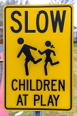 Close Up View Of Slow Children At Play Sign poster