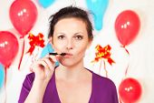 image of electronic cigarette  - Woman with electronic cigarette against decorated wall - JPG