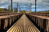 Railway Station Tracks Going Into Perspective. Industrial Landscape With Railroad And Colorful Cloud poster