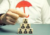 Insurance Agent Protects Wooden Blocks With The Image Of The Euro. Savings Protection. Keeping Money poster