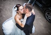 foto of white gown  - Wedding shot of bride and groom in park - JPG
