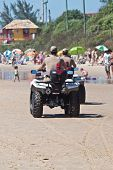 FLORIANOPOLIS, BRAZIL - FEB 3: Police officers patrol the beach to keep visitors safe on Feb 3, 2012