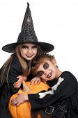 Boy and girl wearing halloween costume with pumpkin on white background