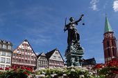 FRANKFURT, GERMANY - AUG 22: The Statue of Lady Justice in Romer Square on August 22, 2012 in Frankfurt, Germany. Romer Square had been the site for the Frankfurt city government for over 600 years.