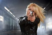 stock photo of gunshot  - special  tactics sexy woman holding up her weapon - JPG