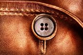 Brown Leather Texture and Button background. Genuine Leather Jacket Detail closeup